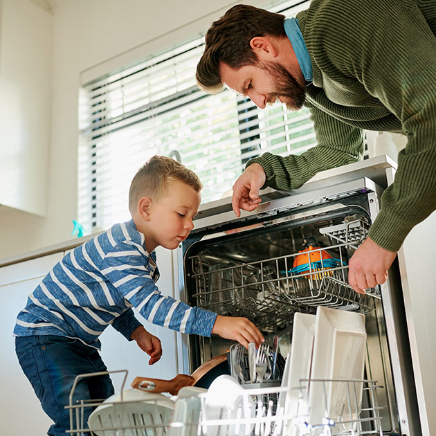 Helping to load the dishwasher